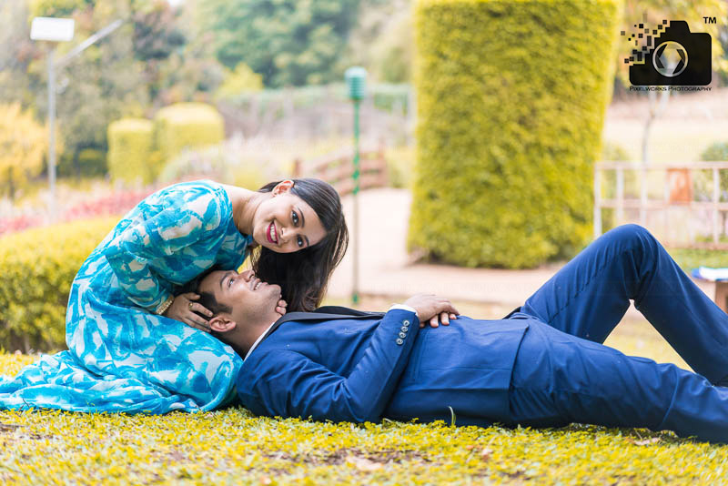 Pre Wedding Shoot Poses lying on the ground and looking camera